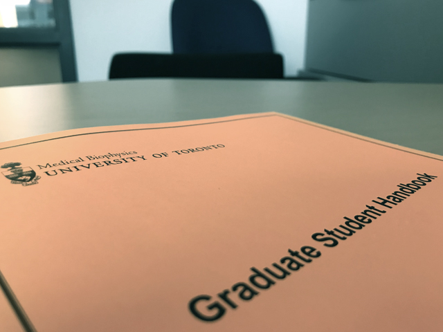Graduate student handbook on a table